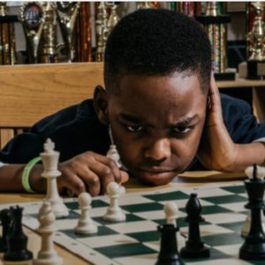 Bill Clinton invites 8year old Nigerian refugee who won a chess competition to his office.